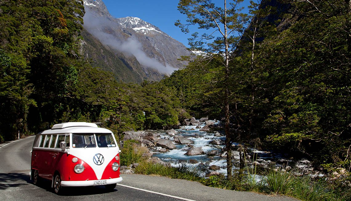 An Old Volkswagon Van Drives Through The Mountains Outside Seattle Washington, Affordable Spring Break Vacations