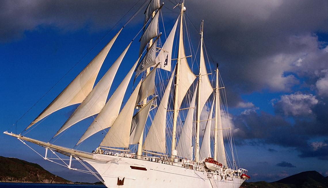 A Small White clipper Sail Boat, Small Cruise Ship Lines