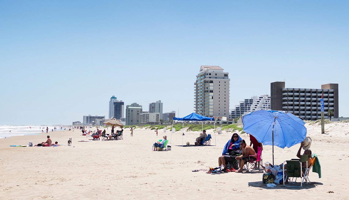 Beachgoers On The Beach In Their Beach Chairs And Sun Shades In South Padre Island Texas, Best Beach Towns