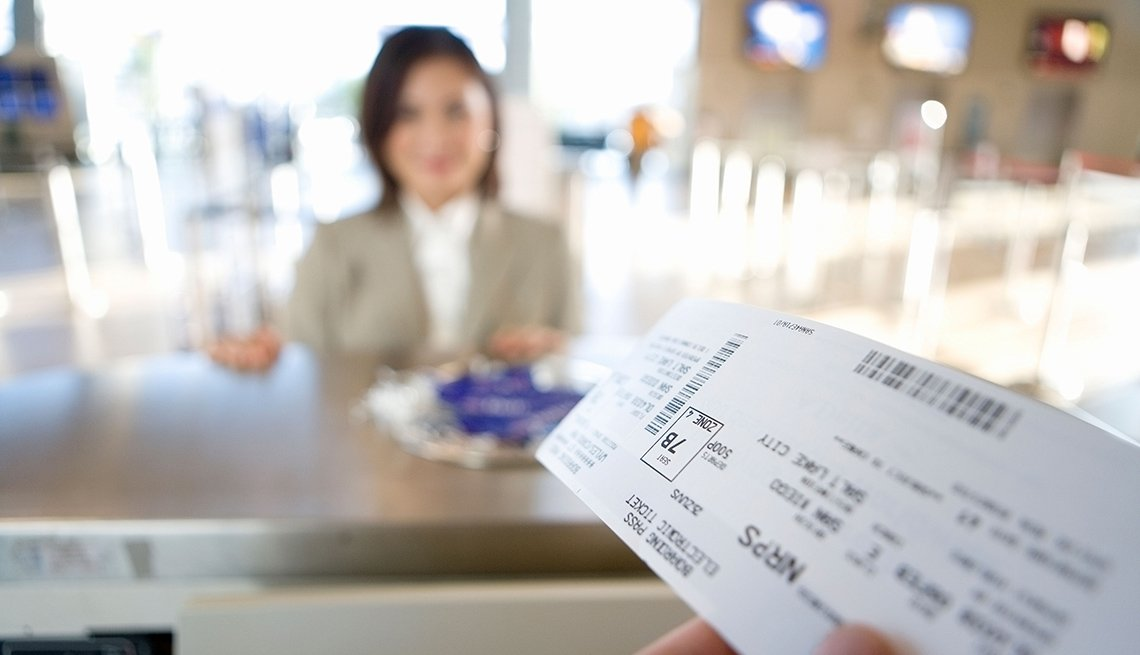 Woman At Ticket Counter In Airport, Must Have Carry On Items