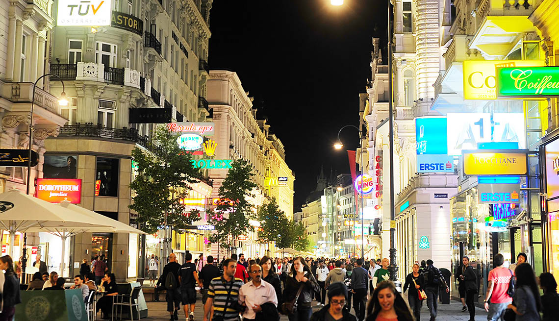 Busy Street Filled With People At Night In Vienna Austria, 10 Summer Destinations