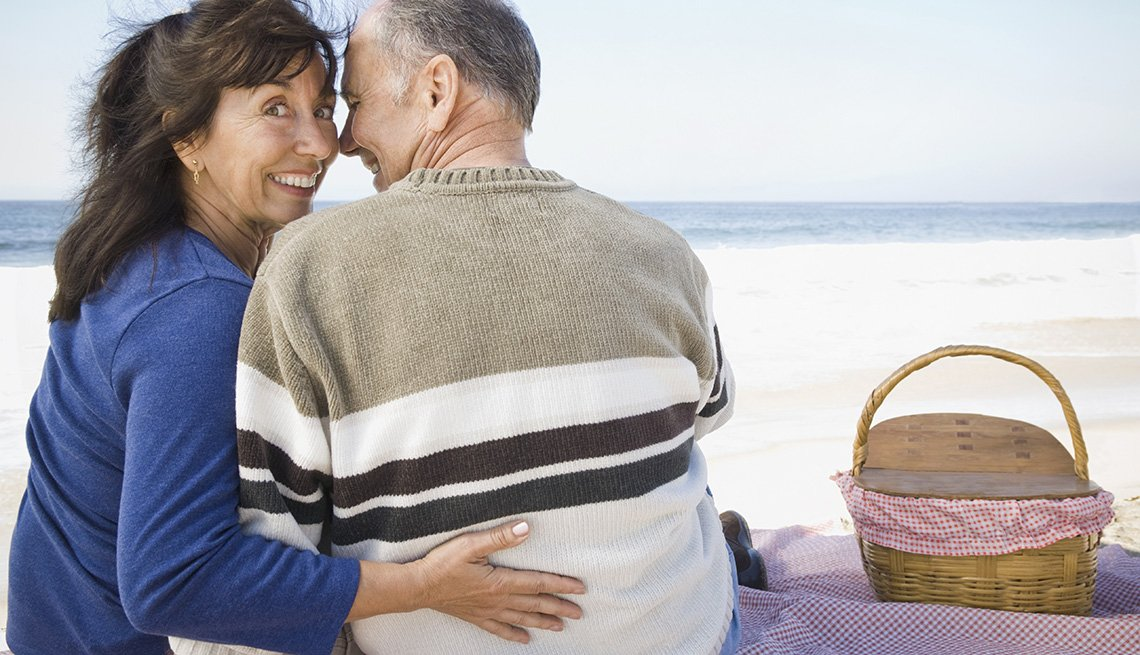 Middled Aged Caucasian Couple Embrace On The Beach In Santa Monica California, Second Honeymoon Destinations