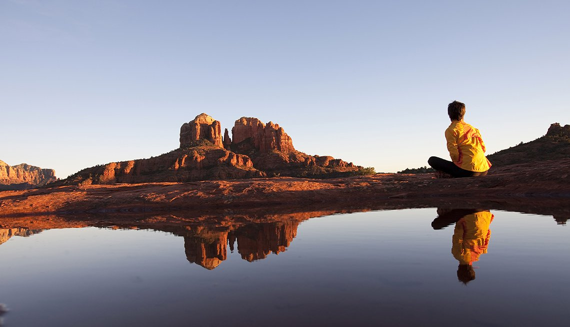 Woman Sits And Relaxes In Sedona Arizona, Wellness Vacation