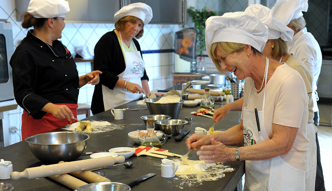 Smiling Middle Aged Caucasian Woman Takes A Cooking Class, Culinary Travel