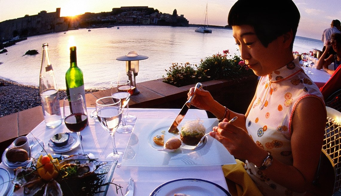 Asian Mature Woman Sits Alone Dining Outdoors, Tips For Older Solo Travelers