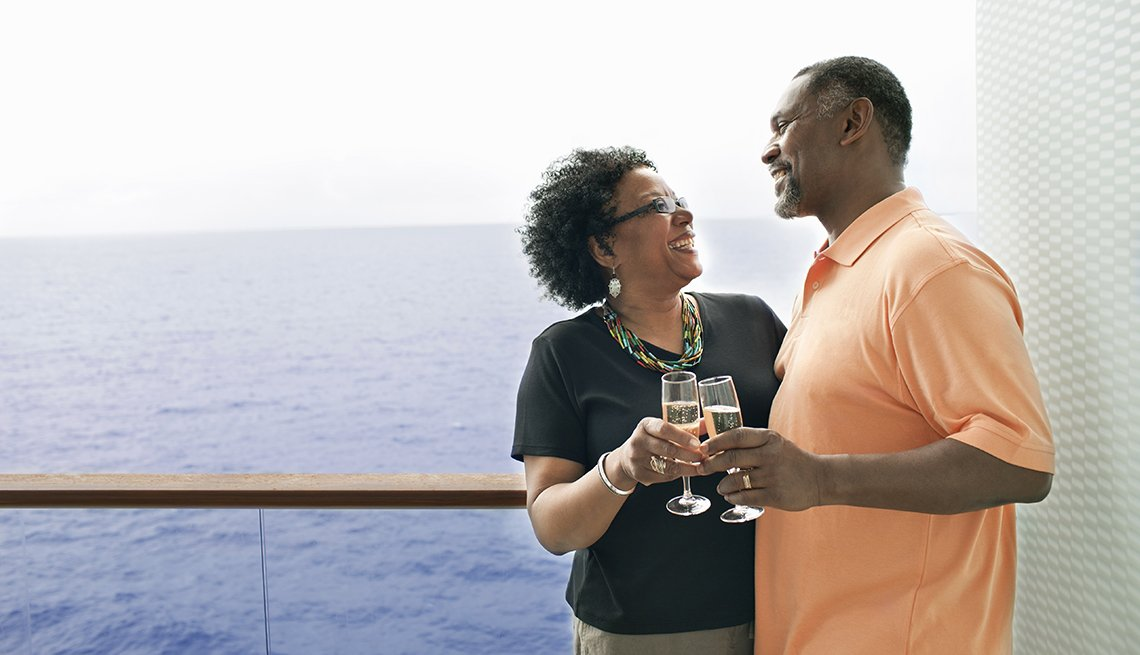 An African American Couple Enjoys Drinks On The Deck Of A Cruise Ship, Theme Cruises