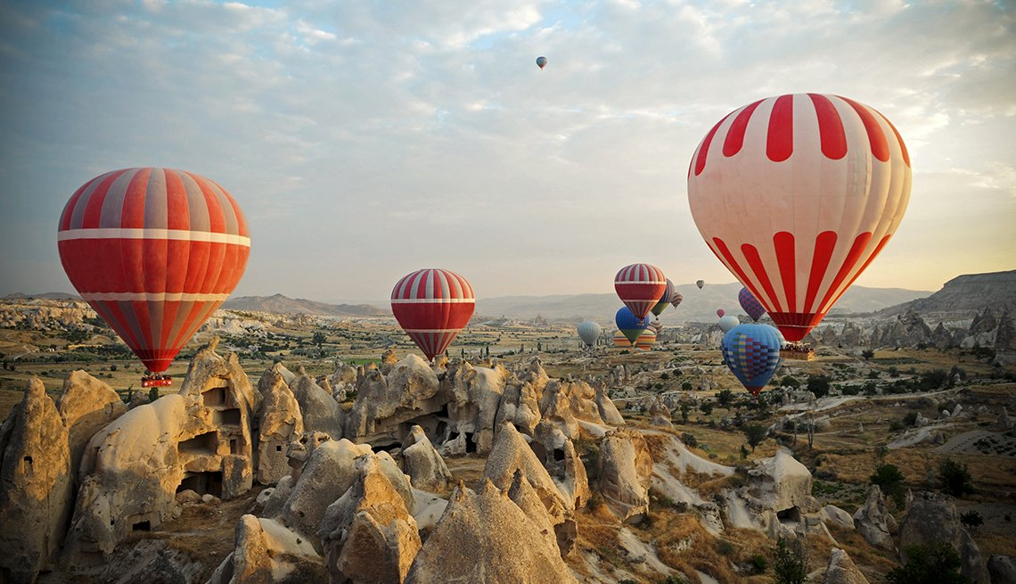 Hot Air Balloons Flying In The Sky Above Cappadocia Turkey, International Ruins