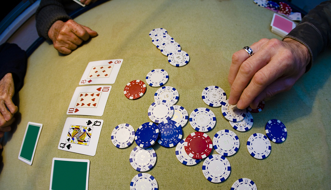 Close Up Of Hands On Poker Hands With Poker Chips And Cards, Theme Cruises