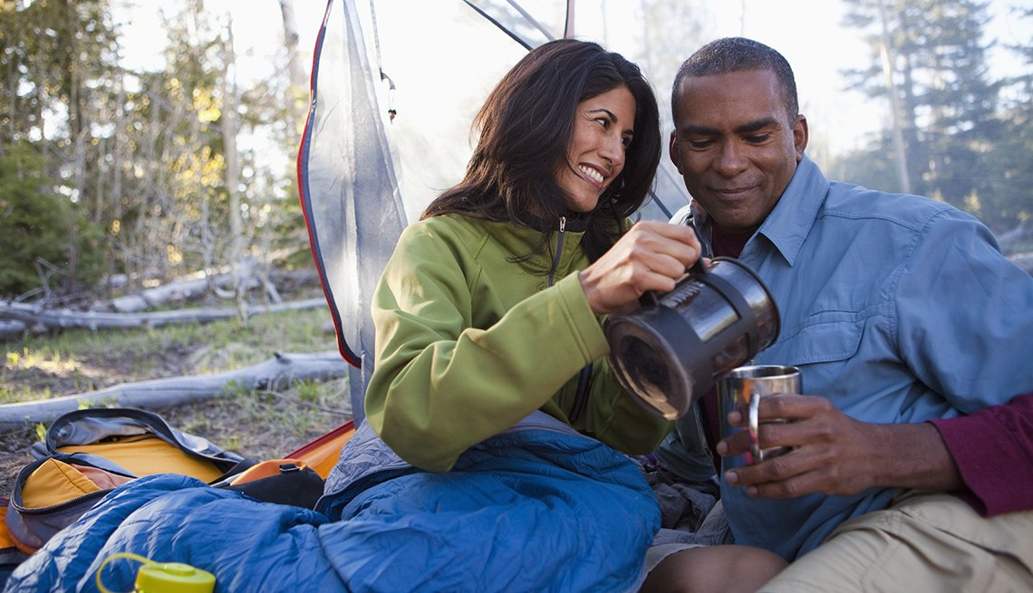 Hispanic Woman Pours Coffee For African American Man At Campsite, Gifts For Travelers