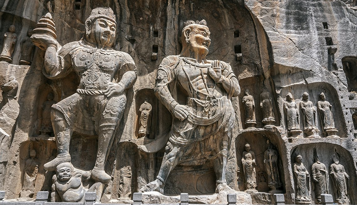 The Carved Buddha Statues At Longmen Grottoes In China, International Ruins