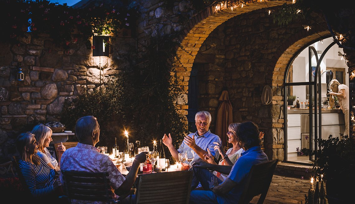 Middle Aged Caucasian Friends Have Dinner Together Outdoors, Travel Trends