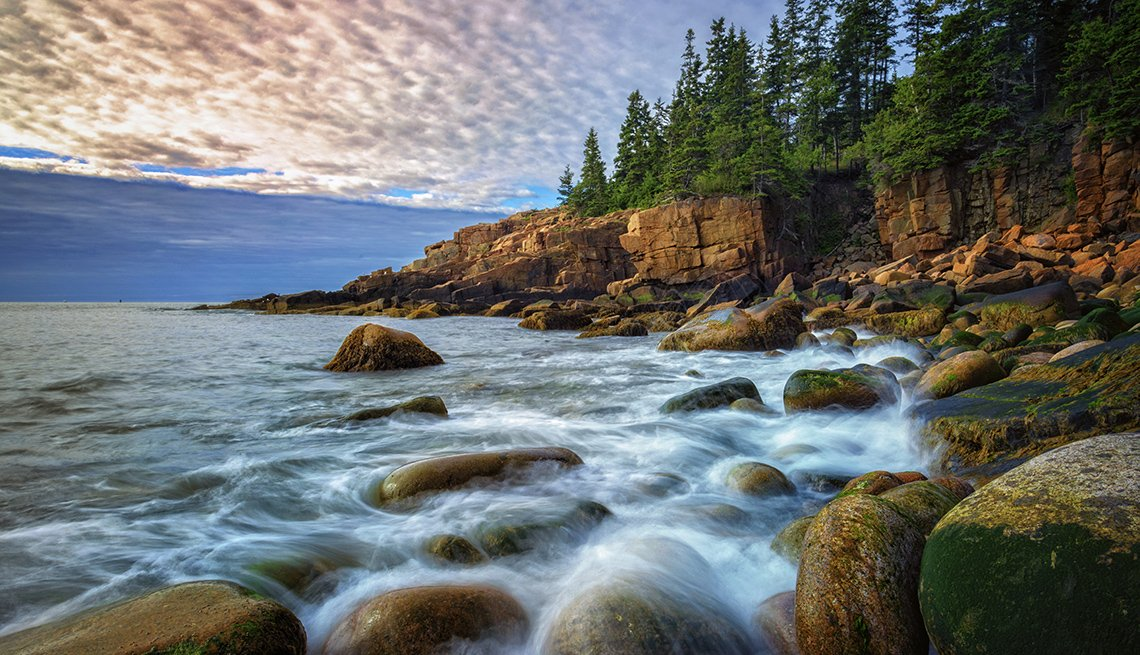 Waves Wash Over The Cobblestones Of Boulder Beach In Maine, Theme Cruises