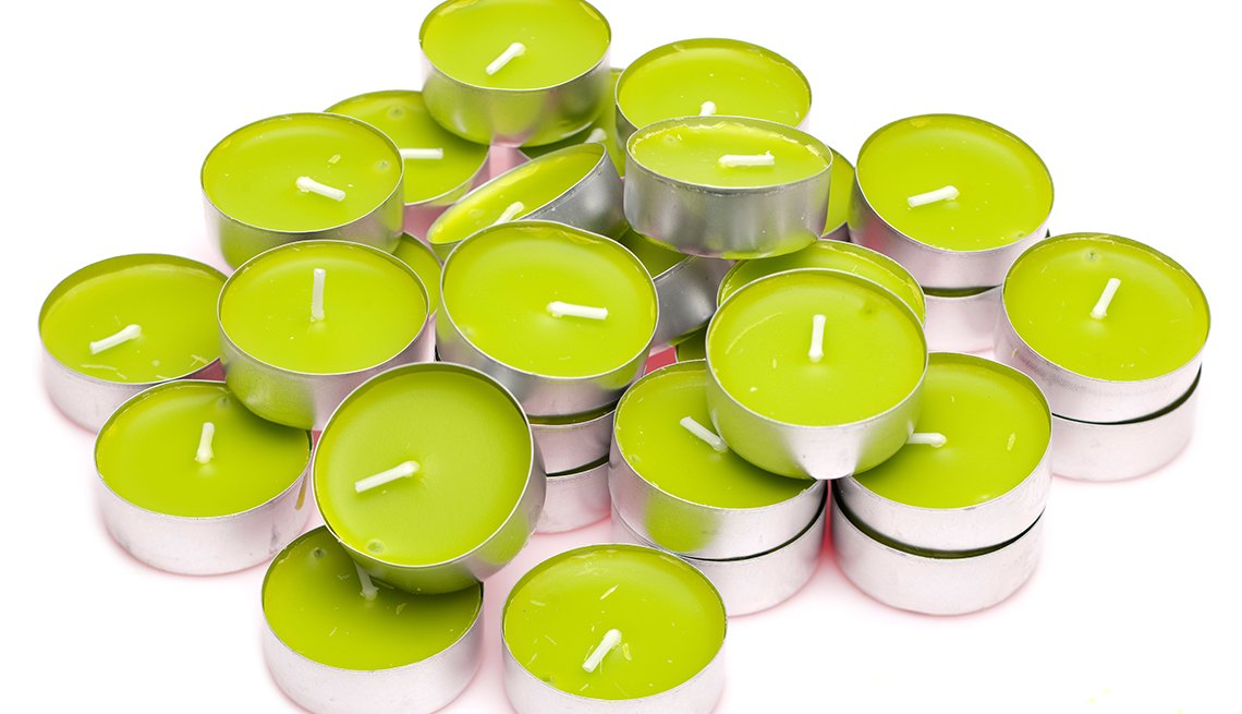 A Pile Of Lime Green Tea Light Candles, Gifts For Travelers