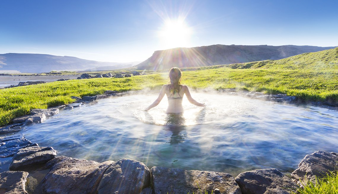 Woman Enjoys A Natural Hot Spring, Travel Trends