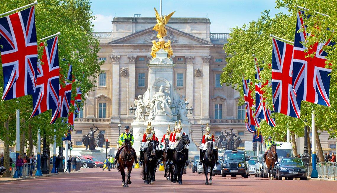 horses and riders parade near Buckingham Palace