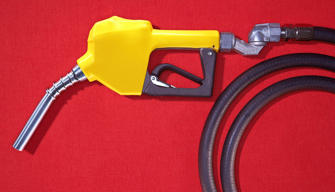 A yellow gas nozzle on a red background