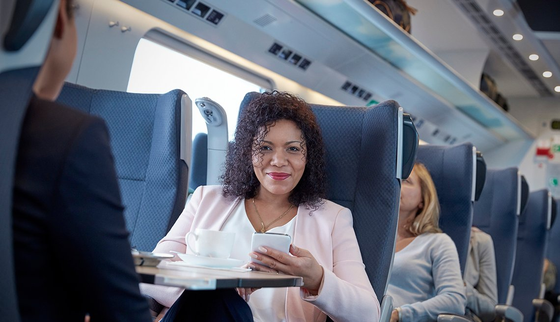 woman using cell phone on train