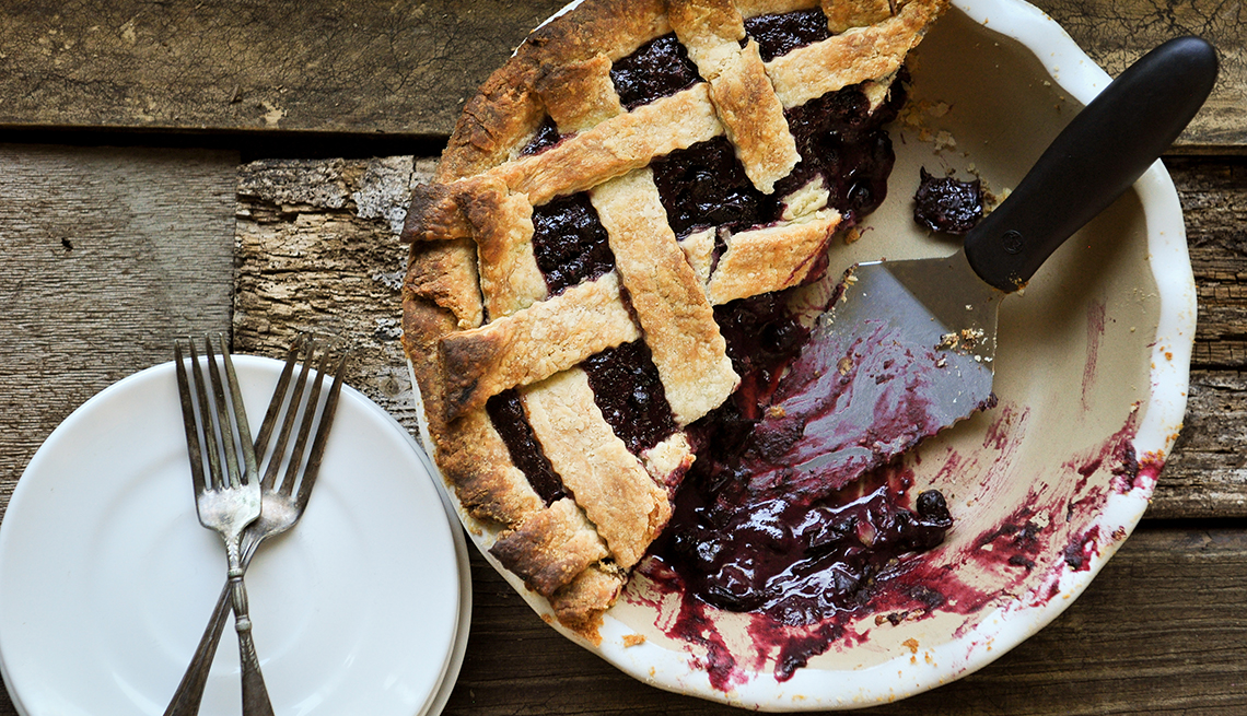 Top Horizontal Shot Of Lattice Topped Pie On Stone Plate Wood Background