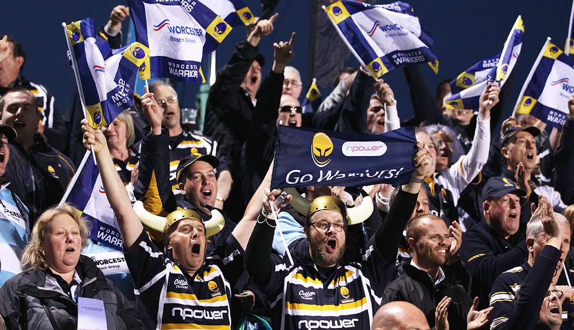 Worcester Warriors fans cheer at a rugby game