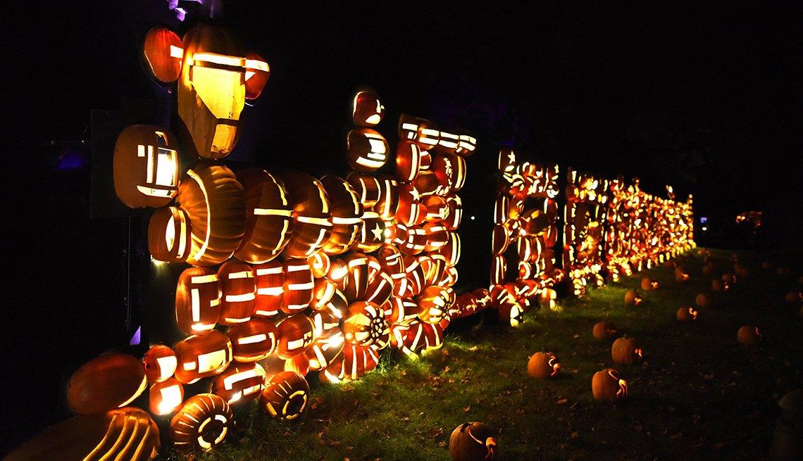 Illuminated pumpkins in the shape of a train displayed at Van Cortlandt Manor
