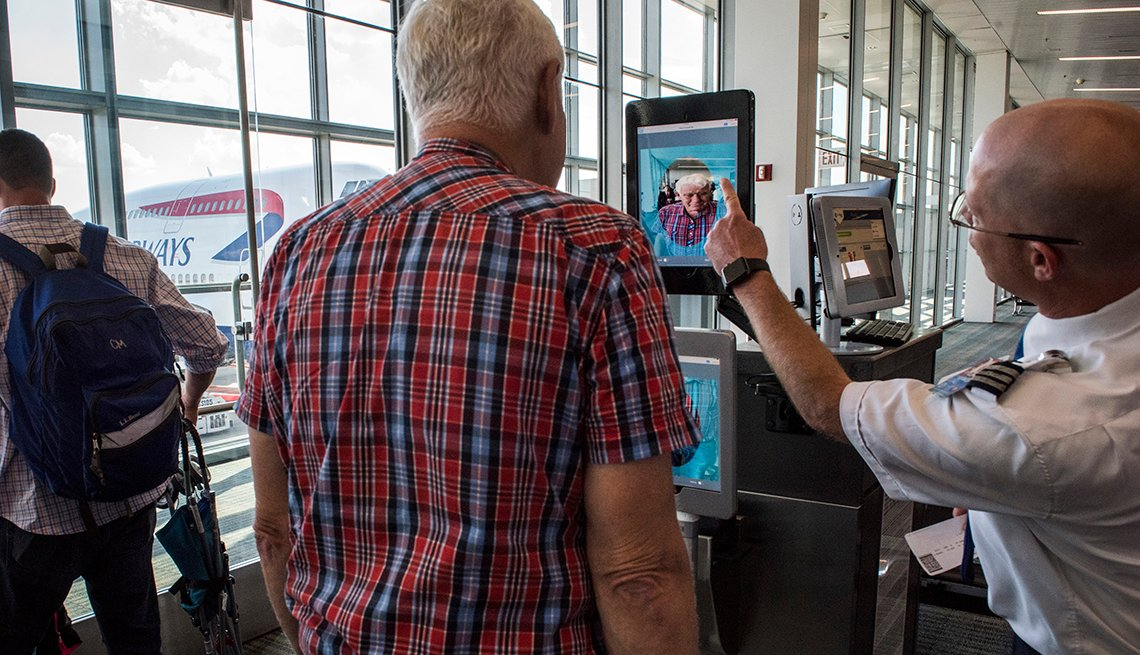 man in front of a facial ID screen at Dulles Airport