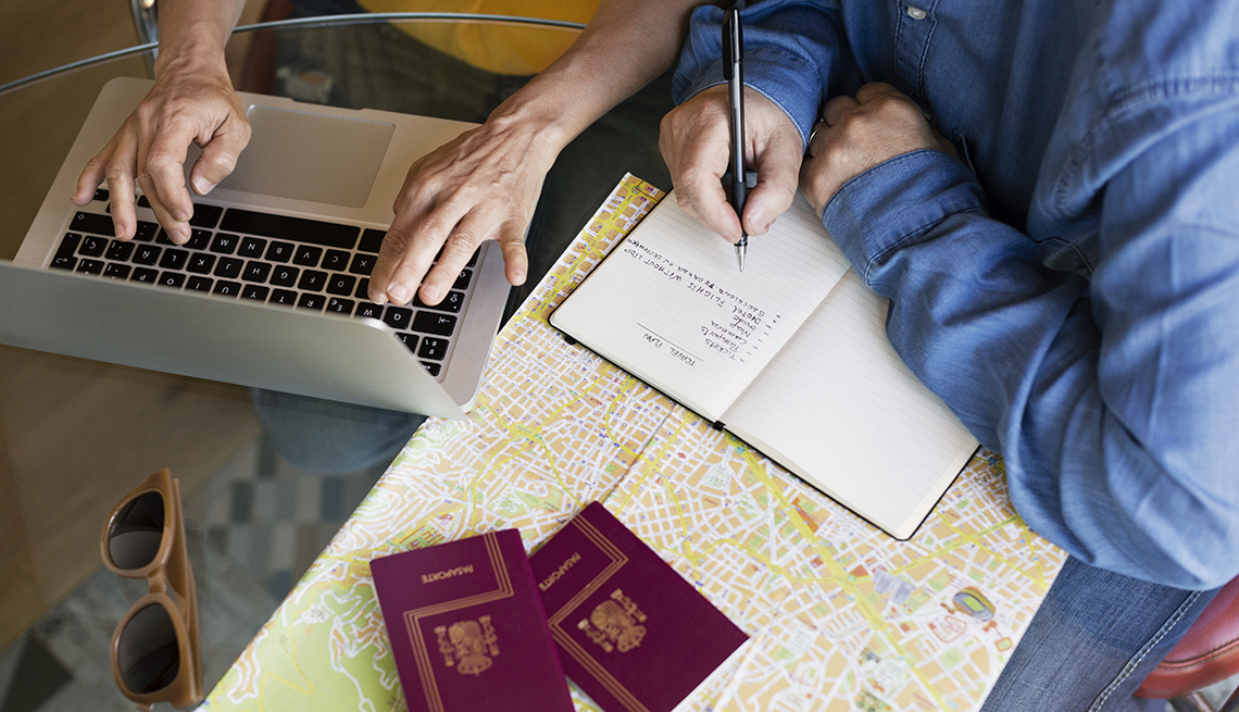 Two people planning a trip at a desk