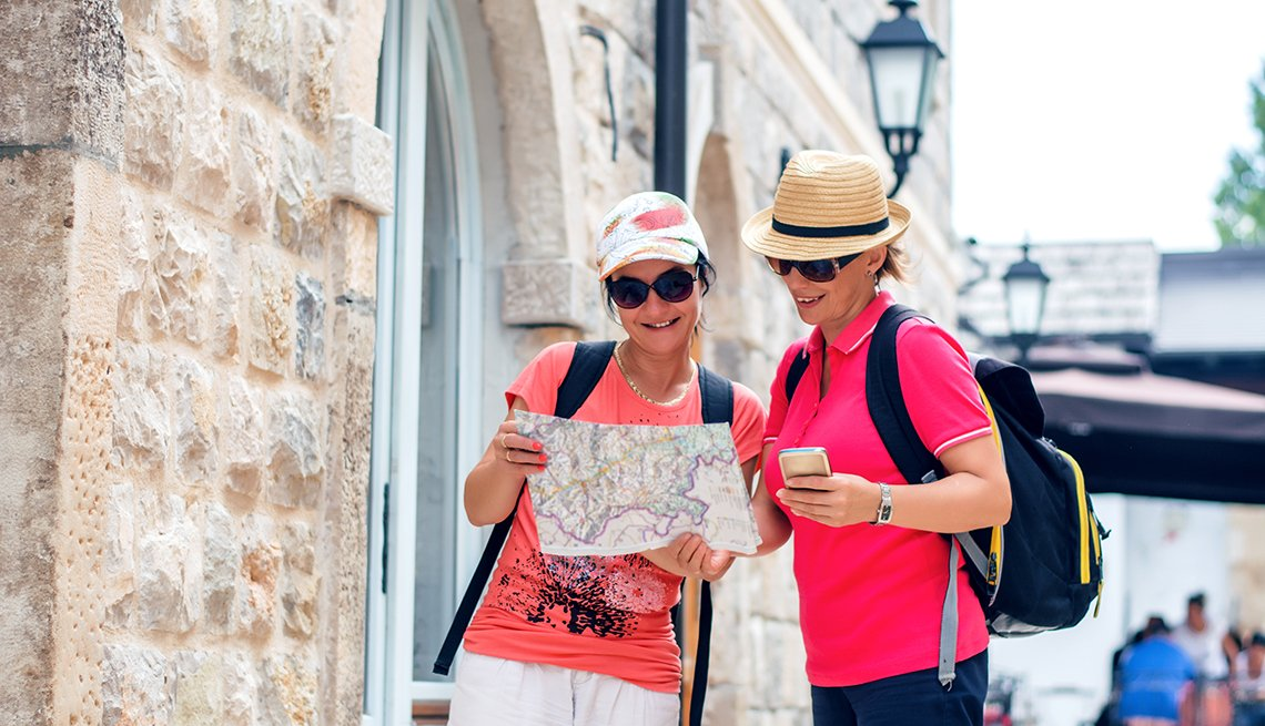 Tourist women with map in a city
