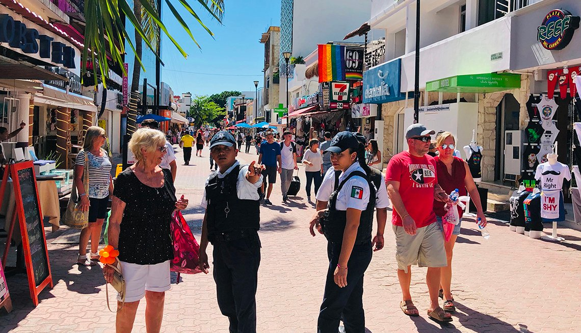 Police offers give instructions to tourists.