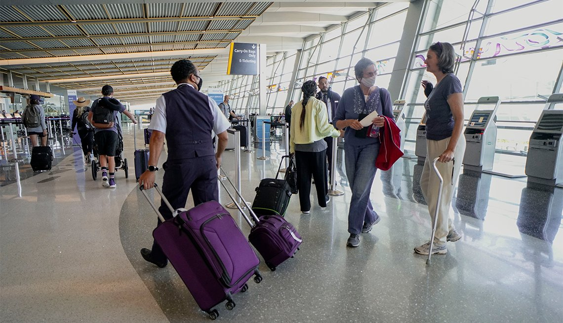 Passengers check in for their flights at San Diego International Airport on May 20, 2020 in San Diego, California