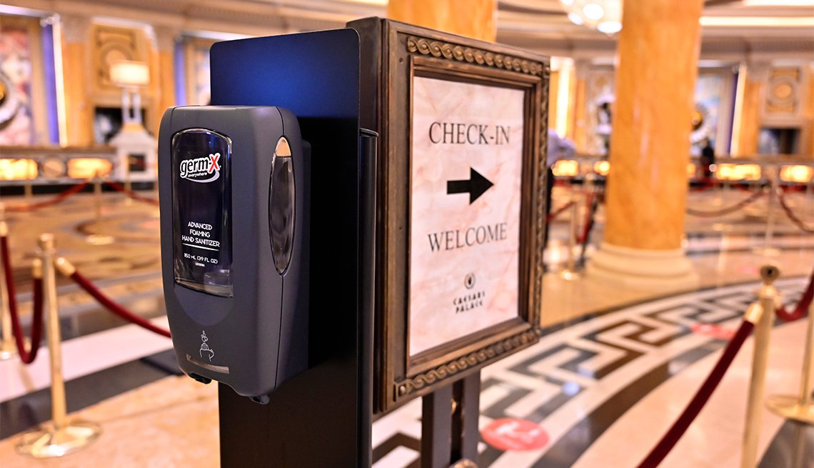 A hand sanitizer dispenser is posted is the lobby at Caesars Palace on the Las Vegas Strip