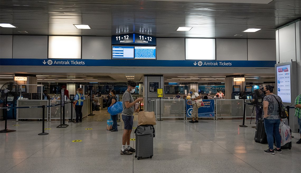 People wearing masks are seen waiting in the Amtrak area of Penn Station on July 9, 2020