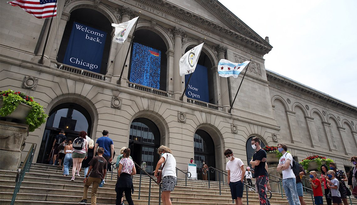 People line up outside the Art institute of Chicago as the museum re-opens on Thursday, July 30, 2020 in Chicago