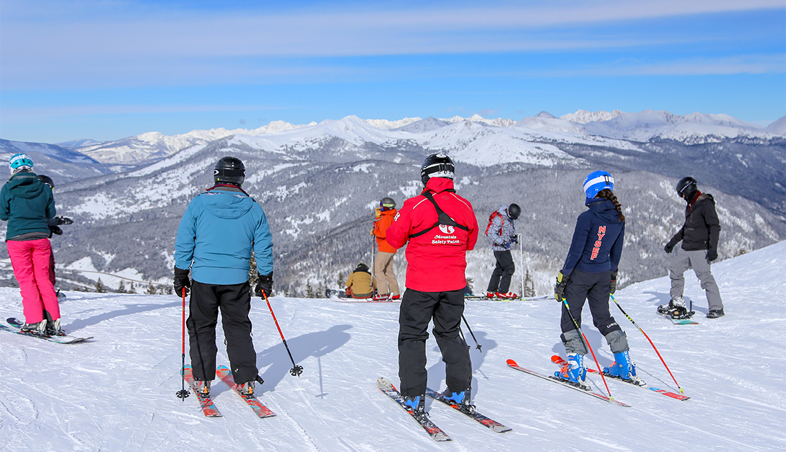 Skiers and snowboarders at the top of Copper Mountain at Copper Mountain in the Colorado Rockies