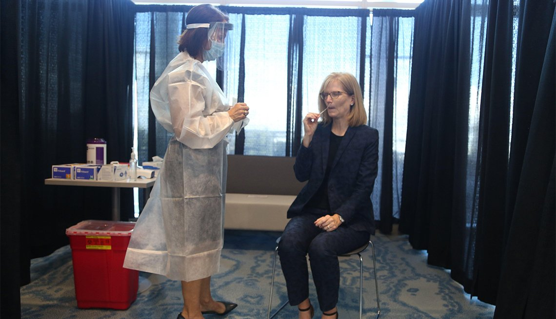 A Tampa International Airport female employee gets tested for COVID-19