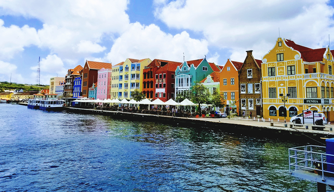 item 4 of Gallery image - multi-colored waterfront homes in Curacao