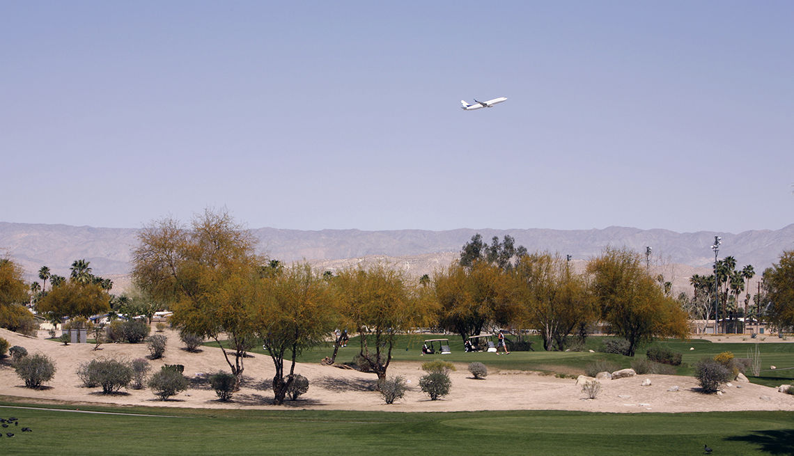 Plane flying over Palm Springs golf course