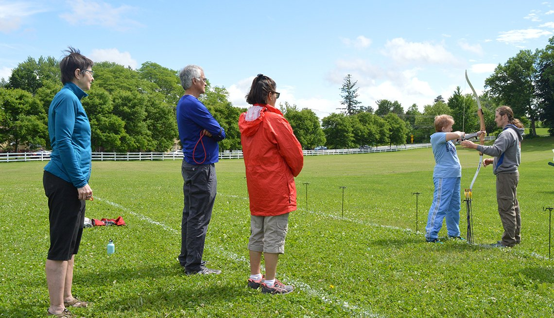 adults practicing archery