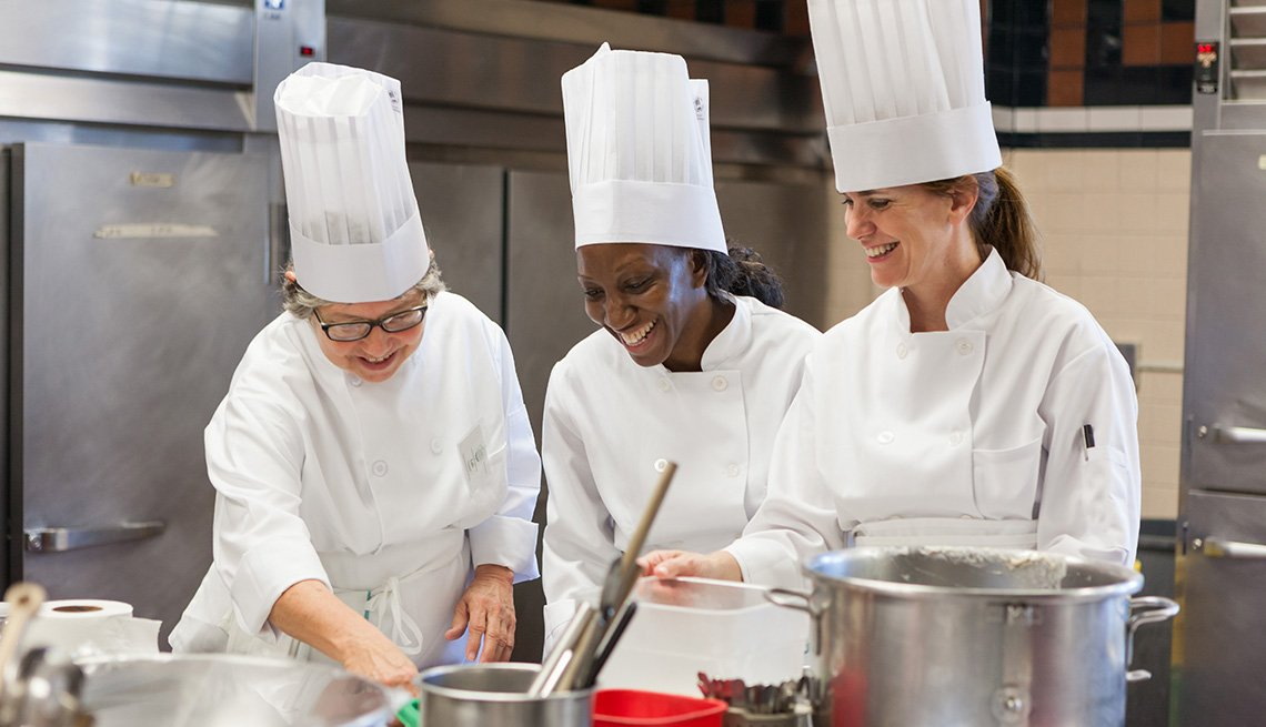 women cooking at The Best of Bootcamp with Chef Hans Welker, Culinary Institute of America