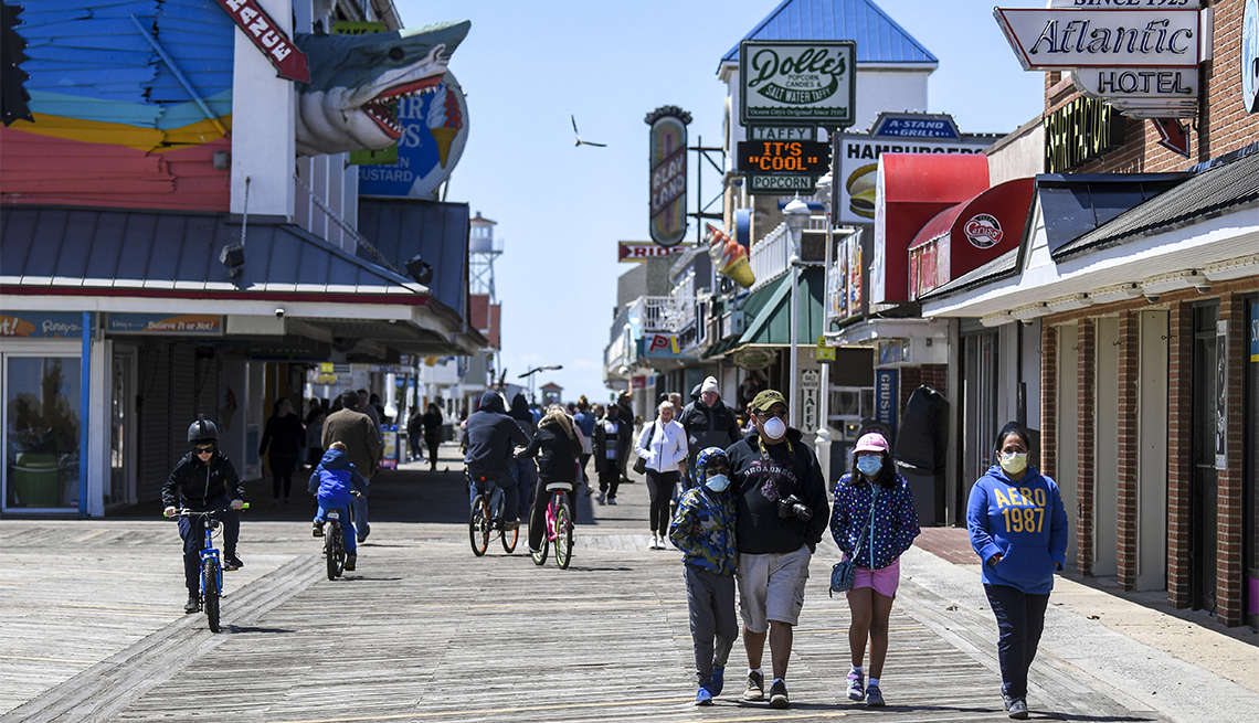 People get out on a cold blustery day to walk the Ocean City, MD boardwalk