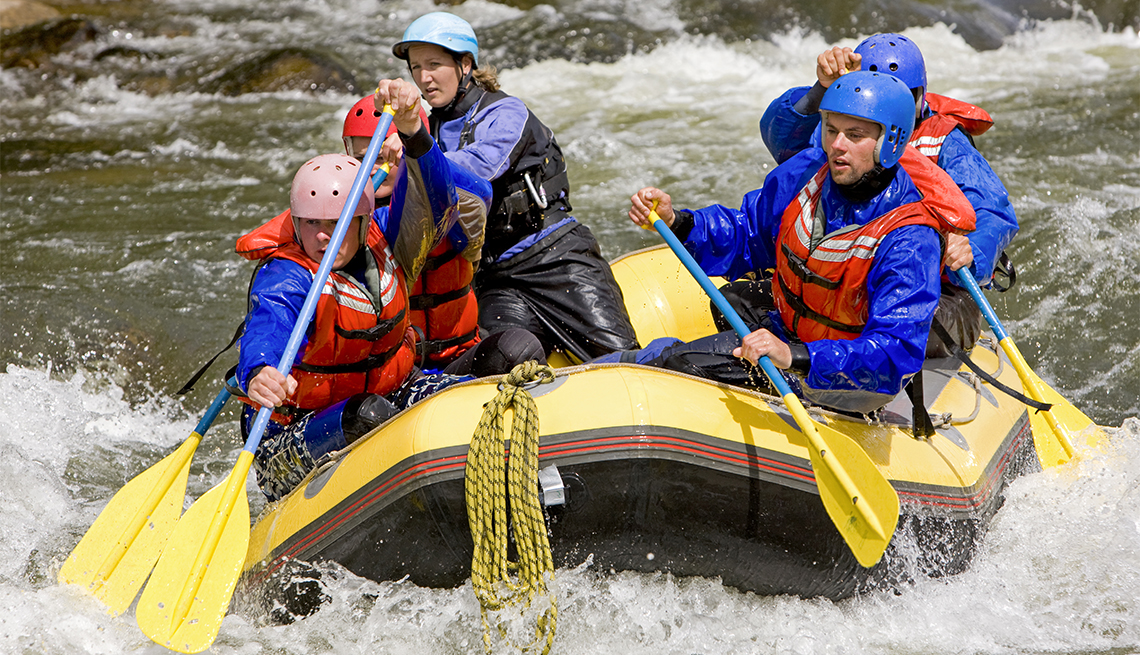 Group of four people with guide whitewater rafting on Arkansas River in Colorado