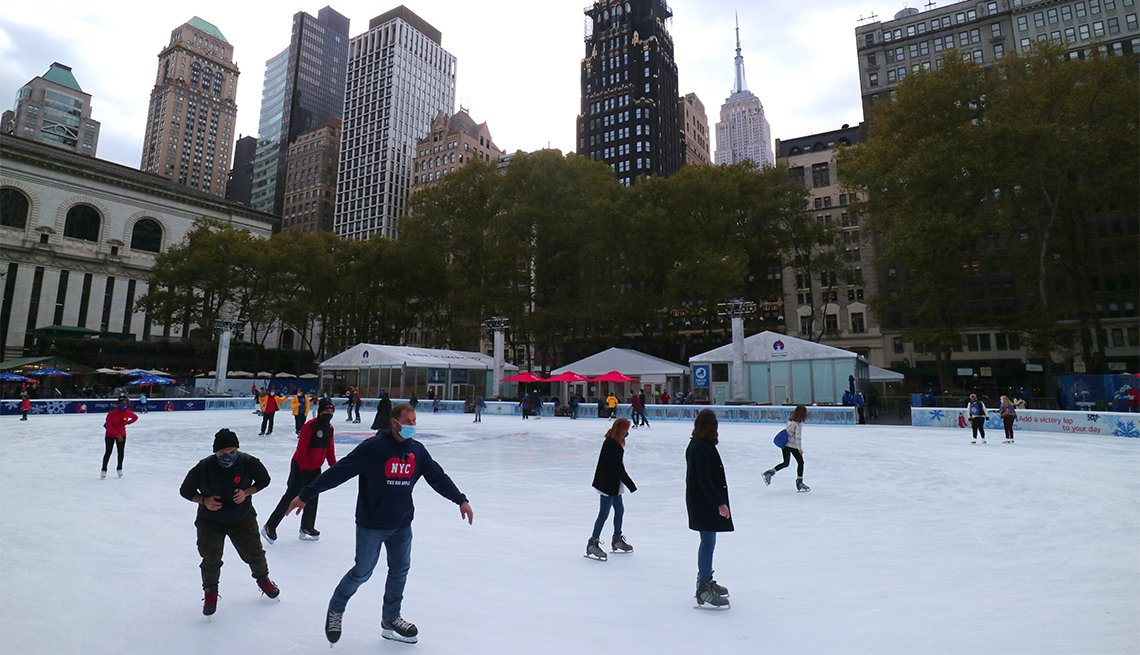 People skate at the annual Winter Village in Bryant Park