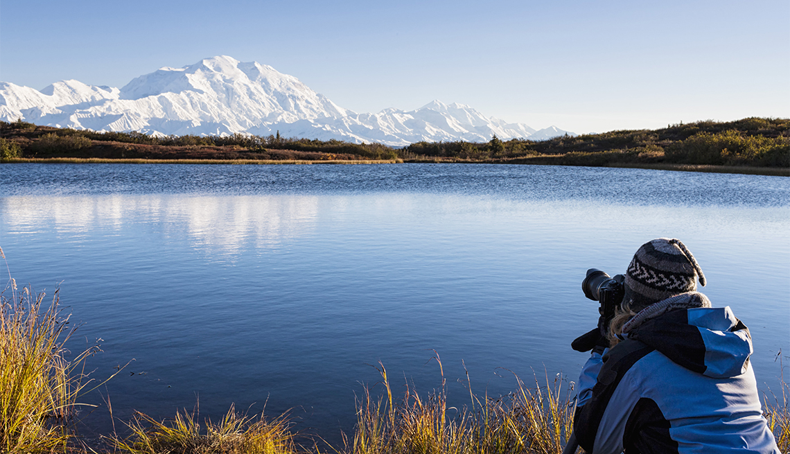 Photographer takes photos from the Mount McKinley, Reflection Pond