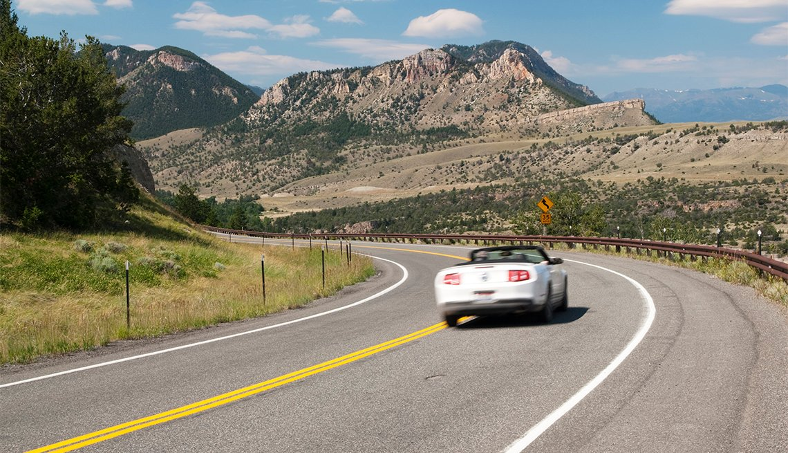 car driving along the Chief Joseph Scenic Byway in Wyoming