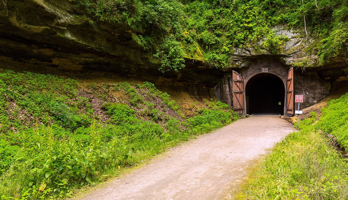item 5 of Gallery image - a bike trail leading into a tunnel that was formerly part of a railroad