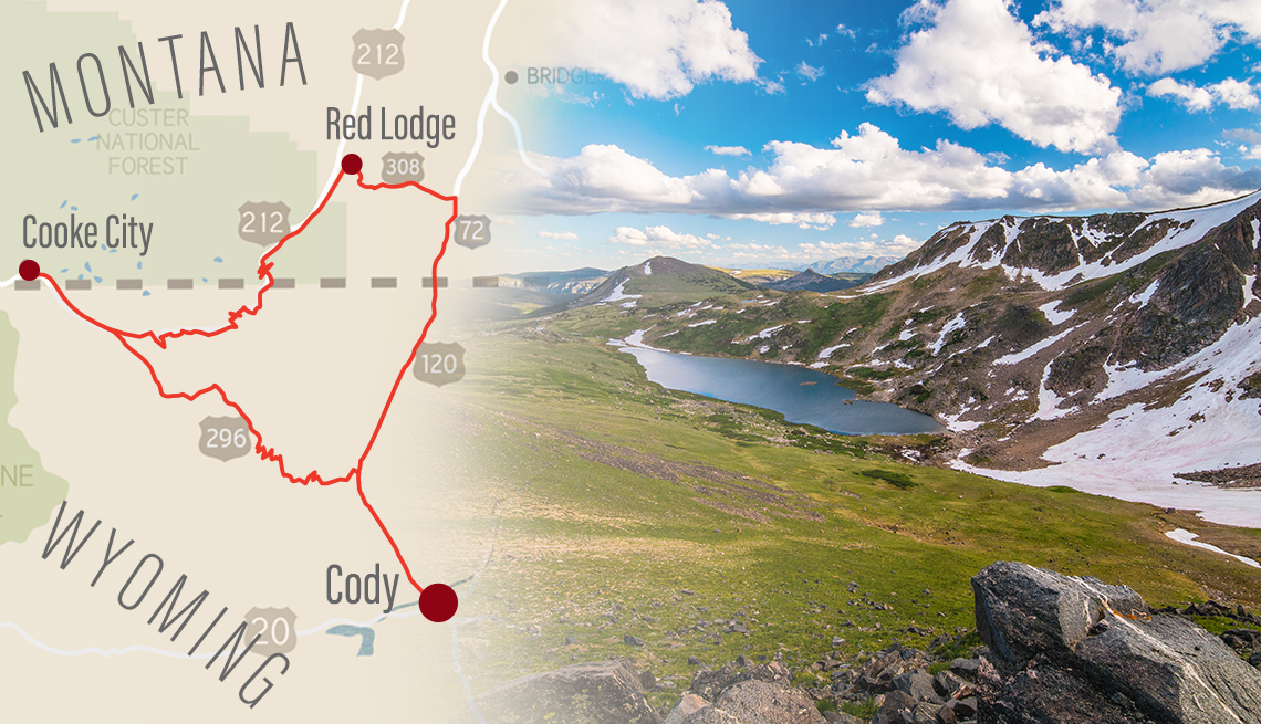 a road map with a driving route marked on it from cody wyoming to points in montana superimposed over a photo taken from the scenic beartooth highway