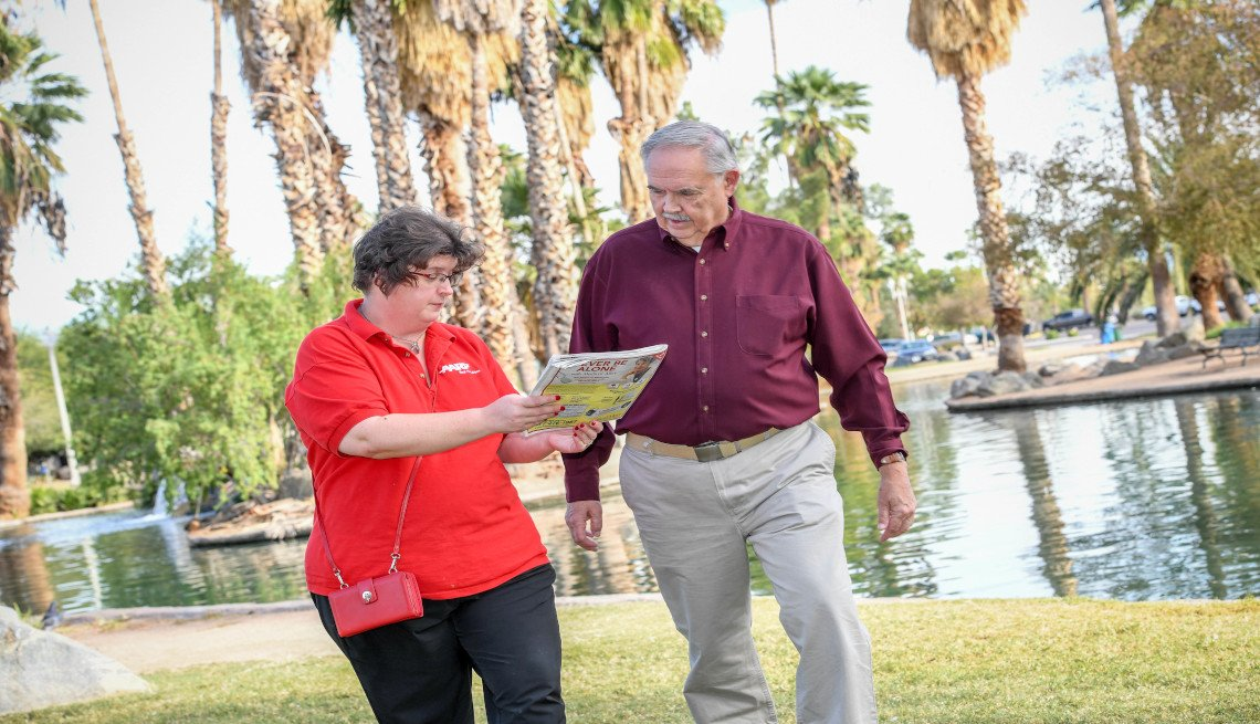 An AARP volunteer discussing with a person in a park in Phoenix, Arizona.