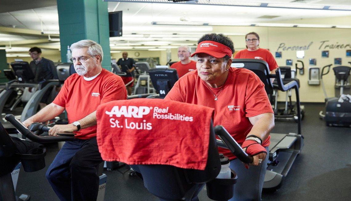Volunteers doing cardio exercises on a bike machine