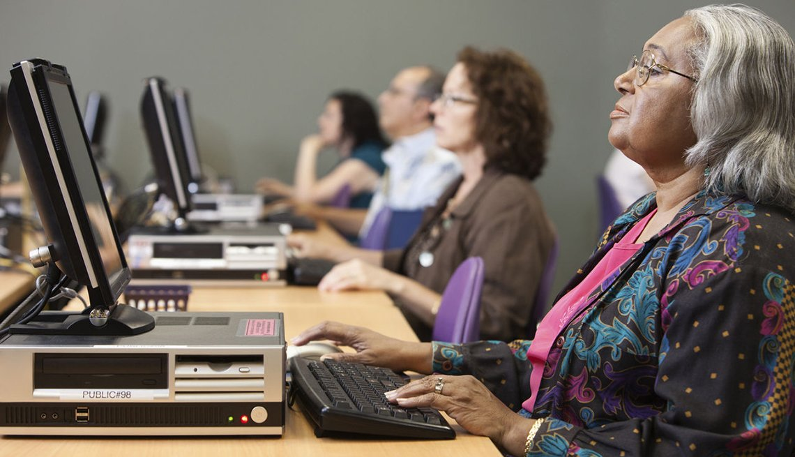 A group of people in a computer and technology class