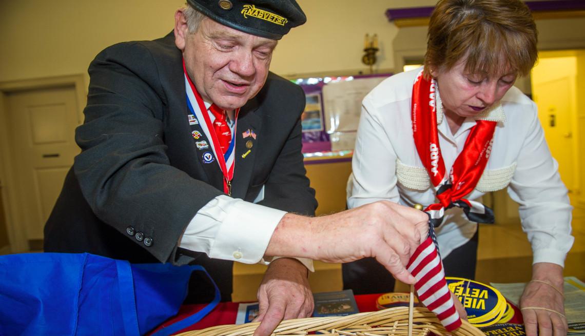 A male veteran and female A A R P volunteer