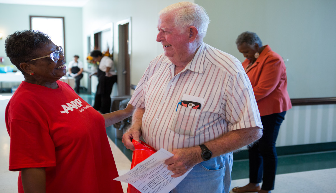 An AARP volunteer talking with a person at Health and Wellness event, Virginia